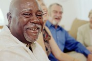 Smiling older man with friends