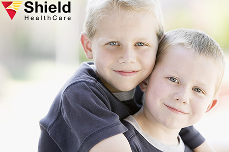 Portrait of twin boys with autism