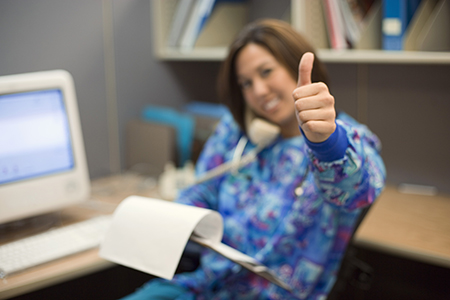 Nurse giving thumbs-up gesture