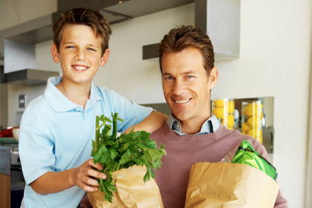 Son and Father in Wheelchair Holding Groceries
